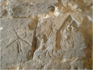 Graffiti in Colchester Castle - St Peter, standing in an arch or doorway