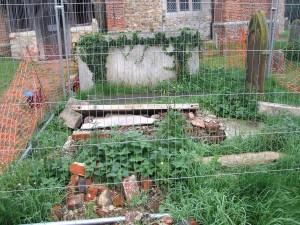 Collapsed vault in church yard at Peldon